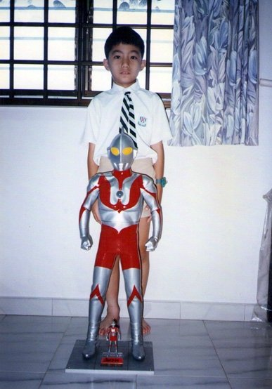 Myself with one of my uncle's giant Ultraman figures in 1996.